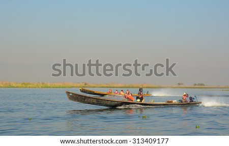 Inle, Myanmar - June 11, 2015. Tourists on motorboat visit at Inle lake, Shan state, Myanmar. Inle Lake is a major tourist attraction, and this has led to some development of tourist infrastructure.