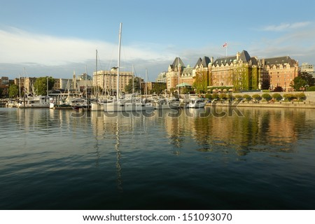 Inner Harbor Afternoon, Victoria, BC. Victoria's Inner Harbor and marina in downtown Victoria. The historic Empress Hotel looks over the harbor. British Columbia, Canada.  - stock photo