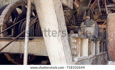 Inner rusted industrial workings of a Gold Dredge from sumpter Oregon with big metal gears and pulleys