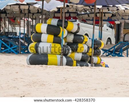 inner-tube for rent on the beach Thailand - stock photo