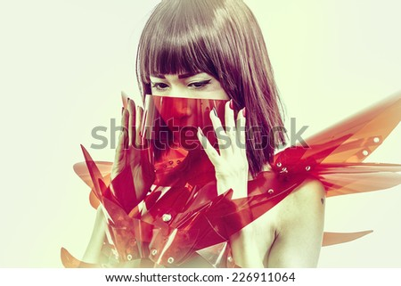 Innocence, beautiful young oriental suit made of red acrylic - stock photo