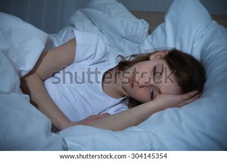 Innocent Girl In Bedroom Having Sleeplessness Night - stock photo