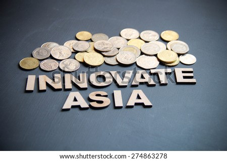 Innovate Asia concept written with wooden letters on blackboard. This photo can use as Business background.  - stock photo