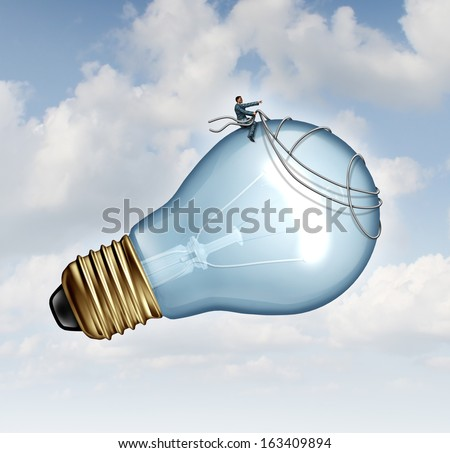 Innovation guidance business concept and creative inspiration with strategic leadership imagination of new ideas as a businessman guiding a giant light bulb using a harness to pilot for success. - stock photo