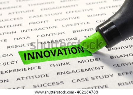 Innovation message highlighted with marker on paper of other related words. For direction of business strategy success concept - stock photo