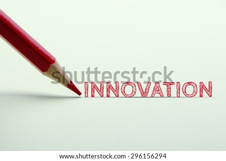 Innovation word is standing on the paper with red pencil aside.