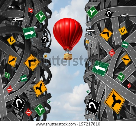 Innovative leadership with a businessman in a hot air balloon flying upward and escaping the confusion of tangled roads and confusing traffic signs as a concept and metaphor for ignoring obstacles. - stock photo