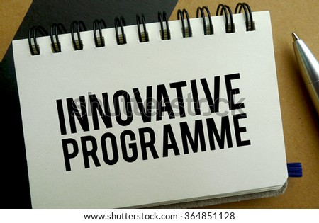 Innovative programme memo written on a notebook with pen