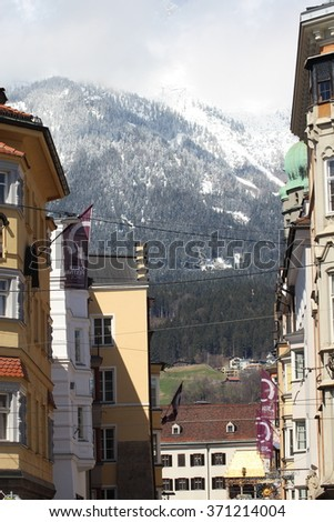 INNSBRUCK, AUSTRIA - APRIL 3, 2015:  Old City (Altstadt or Altestadt) and Nordkette view from Maria-Theresien Strasse.