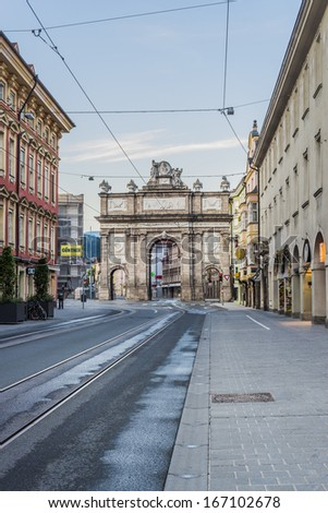 INNSBRUCK, AUSTRIA - AUG 16: Triumphal Arch modeled after those in Rome on the south end of the main artery of Innsbruck, Maria-Theresien Street on Aug 16, 2013 in Innsbruck, Austria.