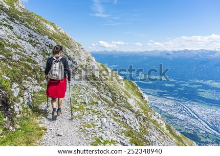 INNSBRUCK, AUSTRIA - AUGUST 16, 2013: Hiker at Norkette mountain and ski area in Tyrol region, nord of Innsbruck in western Austria. - stock photo