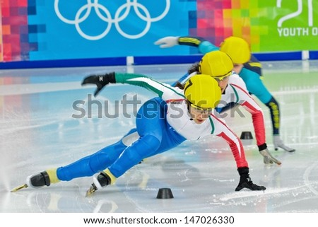 INNSBRUCK, AUSTRIA - JANUARY 18 Arianna Sighel (Italy, #7) is disqualified in the ladies' 1000m  short track B final on January 18, 2012 in Innsbruck, Austria. - stock photo
