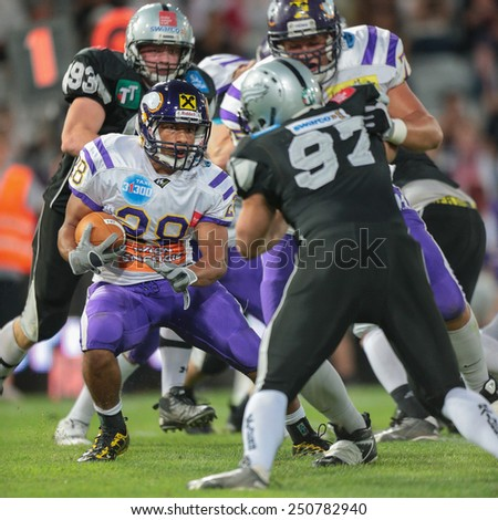 INNSBRUCK, AUSTRIA - JULY 6 RB Jesse Lewis (#28 Vikings) runs with the ball at Euro Bowl XXVII on July 6, 2013 in Innsbruck, Austria. - stock photo