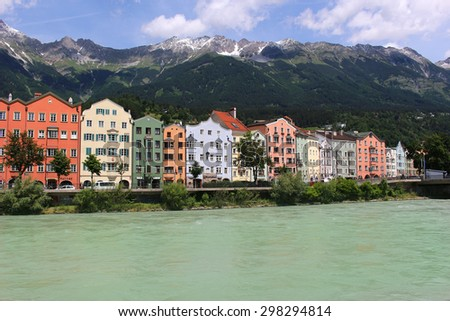 INNSBRUCK,AUSTRIA,JUNE, 22,2015: Colorful houses along the river in Innsbruck, Tyrol, Austria with mountains in the background - stock photo
