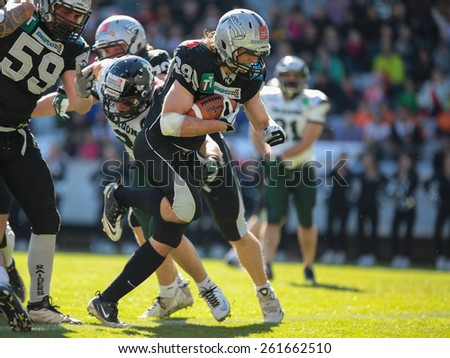 INNSBRUCK, AUSTRIA - MARCH 29, 2014: RB Andreas Hofbauer (#29 Raiders) runs with the ball in an AFL football game. - stock photo