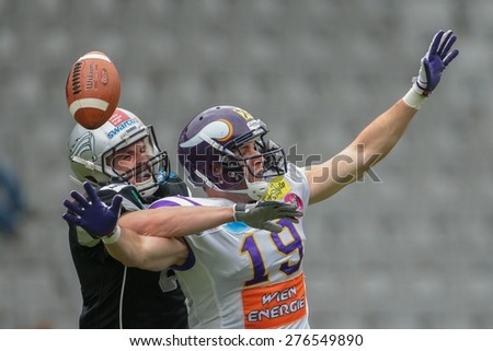 INNSBRUCK, AUSTRIA - MAY 3, 2014: DB Arno Andreas (#8 Raiders) and Stefan Postel (#19 Vikings) fight for the ball. - stock photo