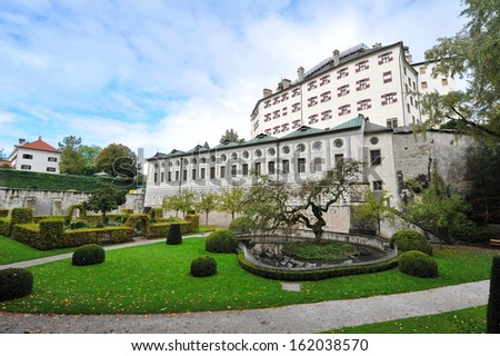 INNSBRUCK, AUSTRIA - OCTOBER 6: Facade and garden of famous and historic Ambras Castle on October 6, 2013 in Innsbruck