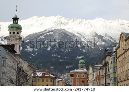 Innsbruck (Tirol's capital city) Nordkette mountains. The view is from the Old City (Altstadt) of Innsbruck, Austria. - stock photo