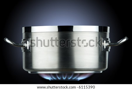 inox saucepan with gas flame - stock photo