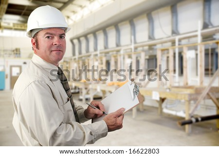 Inpector performing an audit of a plumbing factory. - stock photo
