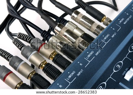Inputs and jacks of small studio mixer - stock photo