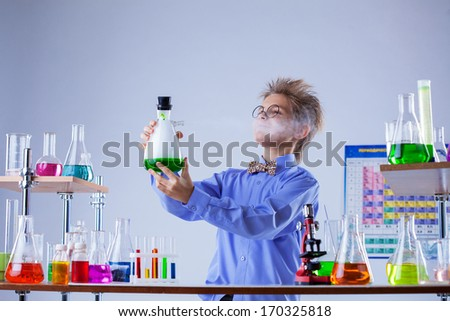 Inquisitive boy looking for evaporation of reagent - stock photo