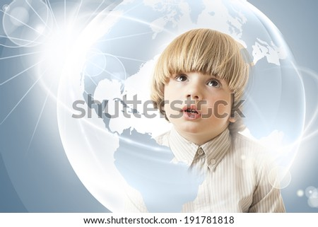 Inquisitive, curious young boy looking with amazement at a globe, dreams of traveling the world Concept of hope, future generation and saving environment legacy for future generation   - stock photo