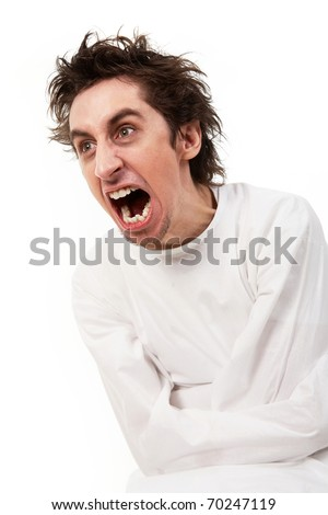 Insane man in strait-jacket screaming in isolation - stock photo