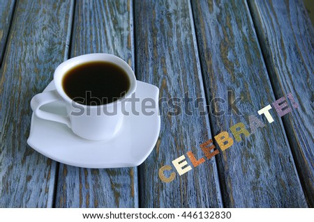 Inscription Celebrate with cup of coffee