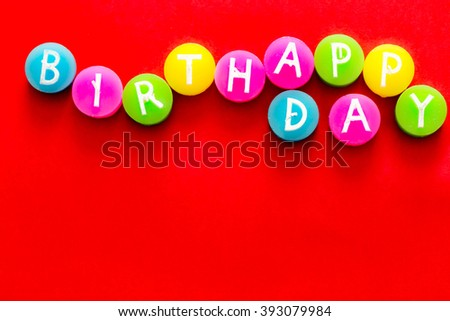 inscription happy birthday colorful circles on a red background