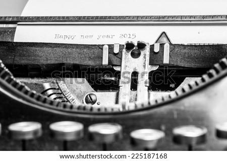 "Inscription ""Happy new year 2015"" written on an old typewriter - stock photo"
