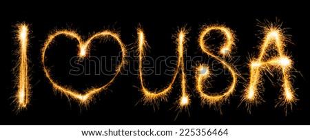 Inscription I love USA made of sparkles on black background - stock photo