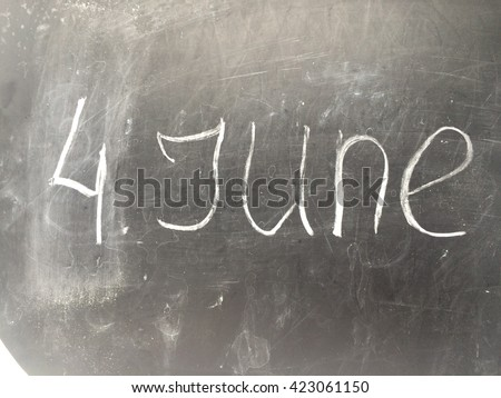 Inscription  4 June on the black chalkboard