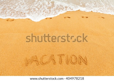 """Inscription """"LEISURE"""" made on beautiful beach by the blue sea - stock photo"""