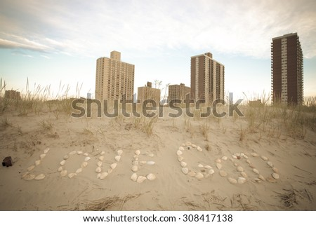 inscription Love God of seashells in the sand on the coast. East rockaway Intel. New-York. US East Coast. - stock photo