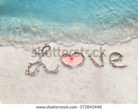 """Inscription """"LOVE"""" in the sand on a tropical island,  Maldives. - stock photo"""
