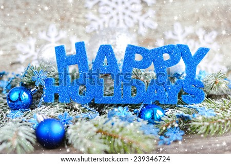 Inscription of happy holidays with christmas decorations - stock photo