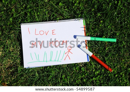 inscription on a piece of paper made by hand of the child - stock photo