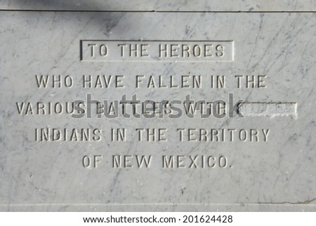 "Inscription on the monument on the Plaza of Santa Fe, New Mexico - the word ""savage"" has been deleted. - stock photo"
