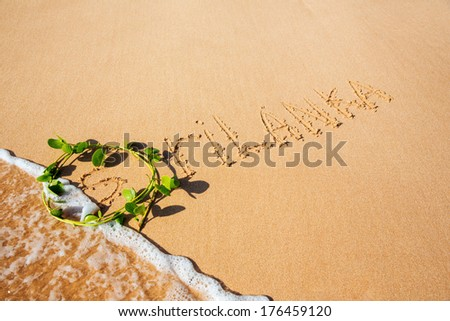inscription on the sand  - stock photo