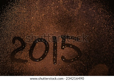 inscription on the wet glass new year 2015 - stock photo