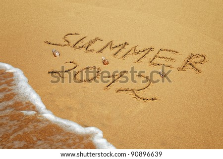 Inscription on wet sand Summer 2012