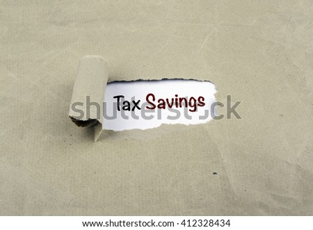 Inscription revealed on old paper -Tax Savings - stock photo