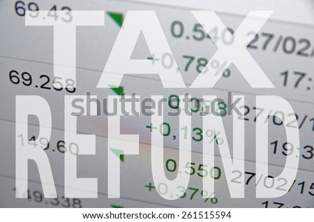 "Inscription ""Tax refund"" on PC screen. - stock photo"