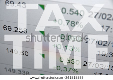 """Inscription """"Tax time"""" on PC screen. - stock photo"""
