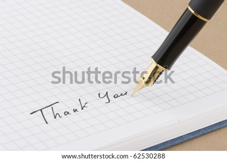 Inscription thank you with gold pen - stock photo