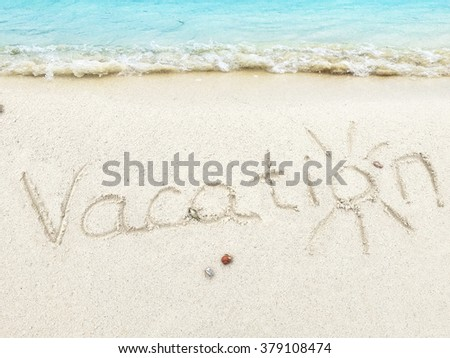 """Inscription Vacations"""" in the sand on a tropical island,  Maldives. - stock photo"""