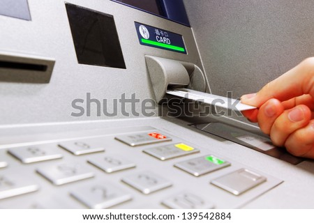 insert card in a ATM machine - stock photo