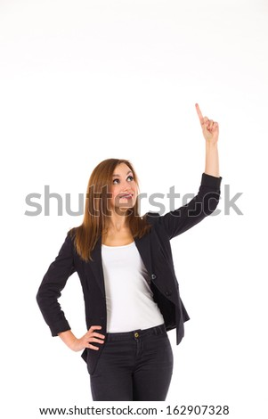Insert text here. Business woman pointing at empty space. Three quarter length studio shot isolated on white. - stock photo