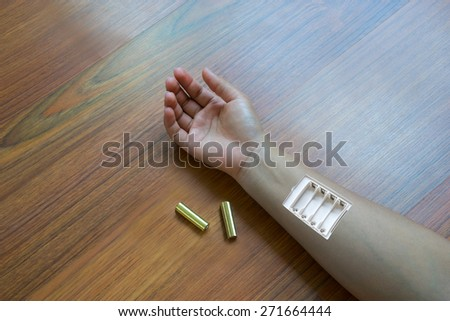 Insert the battery in the arm, Woman arm,Need more power of life,No more power, Tired concept with battery low on hand - stock photo